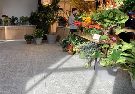 World Streets concrete look porcelain tiles by Vives in Little Spain New York