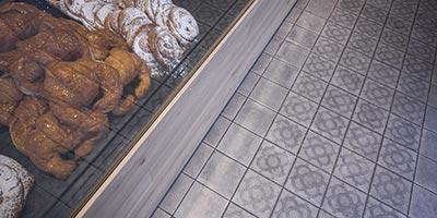 Reforma cafetería con pavimento porcelánico de formato 20x20