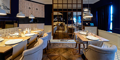 Porcelain white square tile flooring in a restaurant