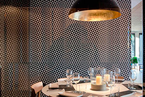 Classic black and white encaustic cement tile with triangle pattern by VIVES